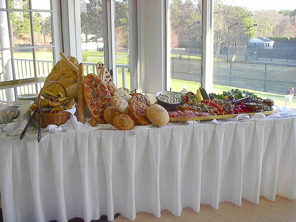 A variety of fresh baked breads and antipasto, beautifully displayed.