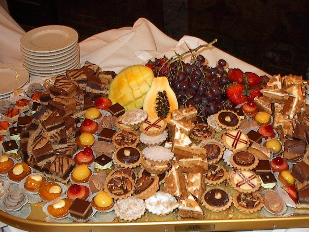 An incredible variety of bite-sized sweets, accompanied by fresh fruit.